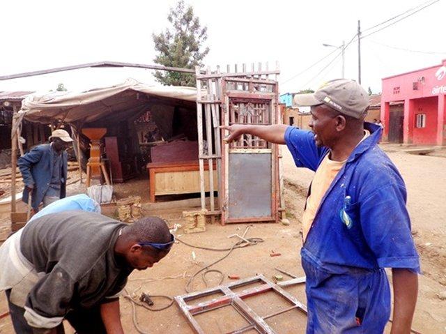Ezra Byiringiro gives instructions at his workshop