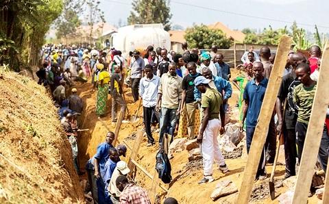 Rwandans working on a trench during monthly community work (Umuganda)