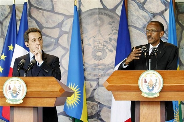 Former French President Nicolas Sarkozy listens as President Paul Kagame responds to Journalists during a joint press conference in Rwanda's capital Kigali