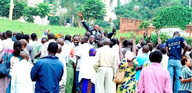 Residents of Byimana Village in Gasabo district toss up their newly elected leader