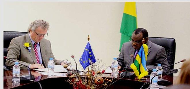 EU envoy to Rwanda Michael Ryan and Rwanda's Finance Minister Claver Gatete signing