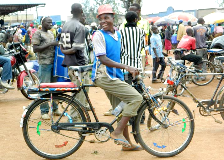 A bicycle taxi operator waiting for clients