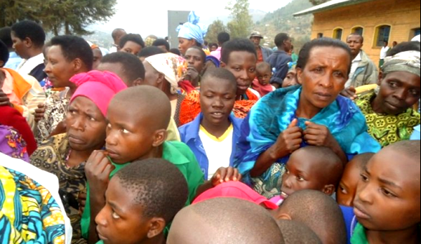 Rushaki sector residents gather in surprise about the recovered baby