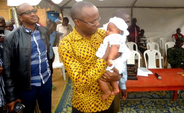 Gicumbi district Mayor holds baby that had been stolen (photos /Eric Muvara)