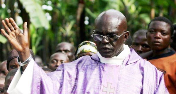 Fr.Ubald Rugirangoga during mass prayer