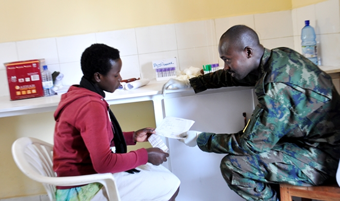 A Rwanda Defence Forces Physician interacts with a Resident in Gicumbi: The Army is currently offering free medical services under the ArmyMedicalWeek.