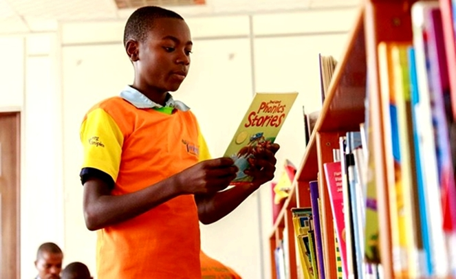 A teenager at a library: The Library-For-All-App will allow easy access to hundreds of books