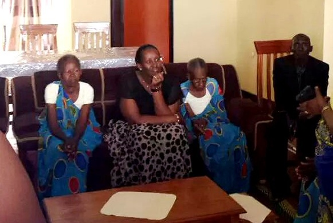The First Lady (center) interacts with genocide widows in one of the new houses shortly after officially handing over the fully furnished houses to the beneficiaries