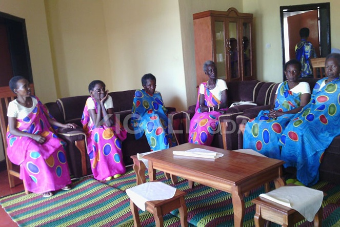 The Genocide widows shortly after they were handed brand new houses fully furnished.
