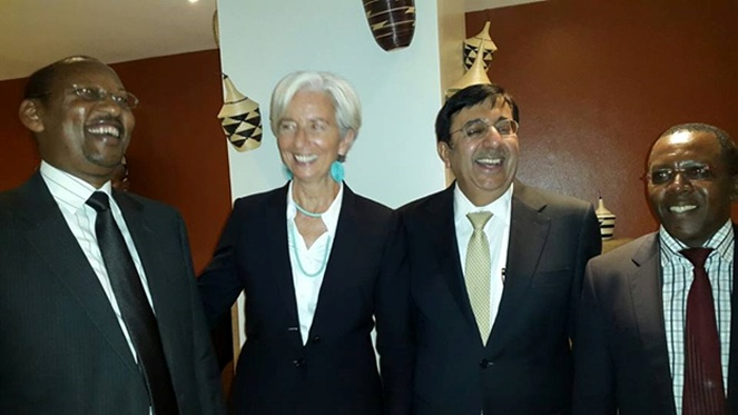 Mr. Sanjeev Anand (center right)  seen in company of IMF director Christine Lagarde (center left), Rwanda's central bank governor John Rwangombwa.