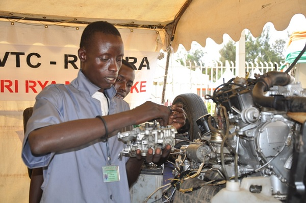 A Youth working on a motor vehicle engine. Youth unemployment is still a big challenge in Rwanda