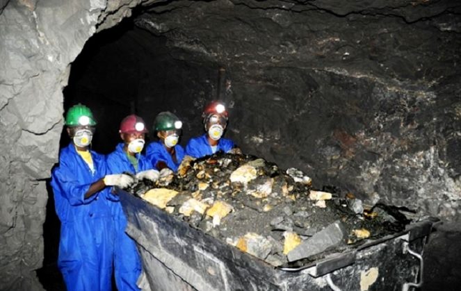 Mine workers show a load of mineral ore. Rwanda government has approved extra licenses to mineral and Quarry sites.
