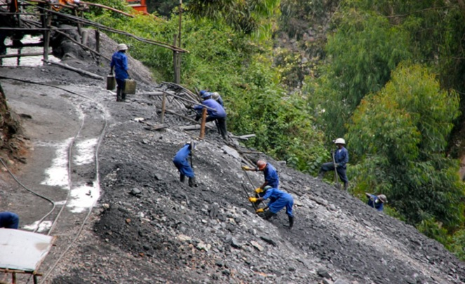 Workers at a tungsten mine site in Rwanda