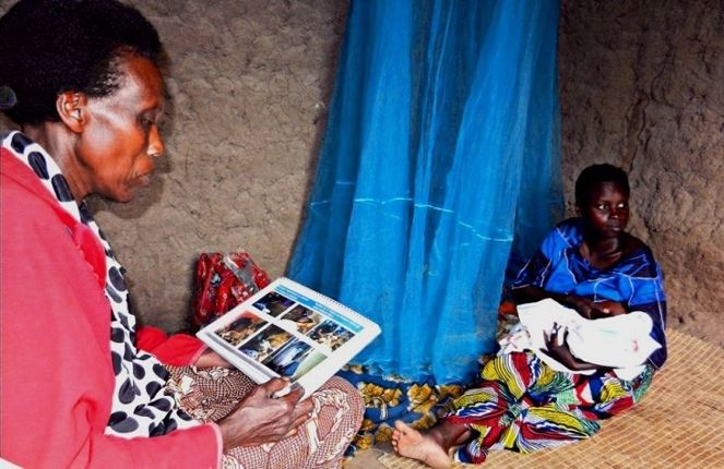 A community health worker interacts with a new mother