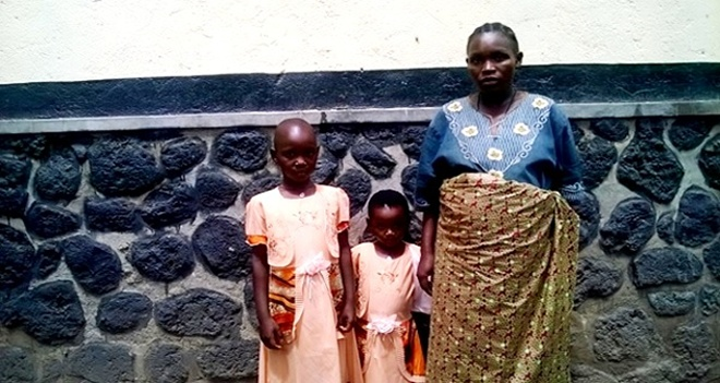 Sergeant Jacqueline Nyirakamana and children on arrival in Rwanda after she managed to convince her husband Lieutenant Colonel Nibabaza to leave DRC.