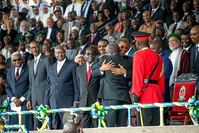 Tanzania President Magufuli hugs his predecessor Jakaya Kikwete