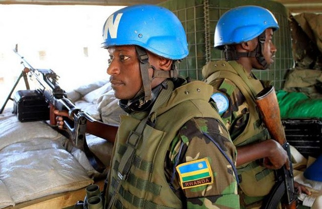 Rwandan peacekeepers stand guard in South Sudan