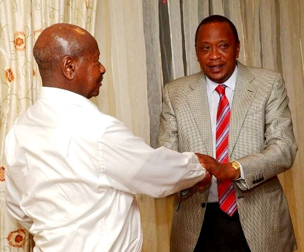 President Yoweri Museveni of Uganda shakes hands with Uhuru Kenyatta of Kenya. Citizens in their countries believe their governments are losing war on corruption