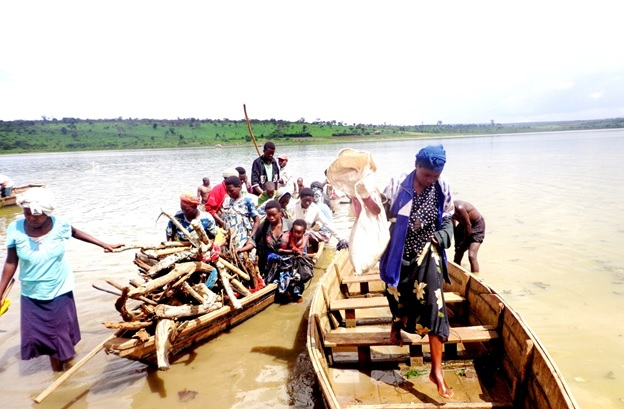 Boats arrive at landing site on Lake Cyohoha in Bugesera District.