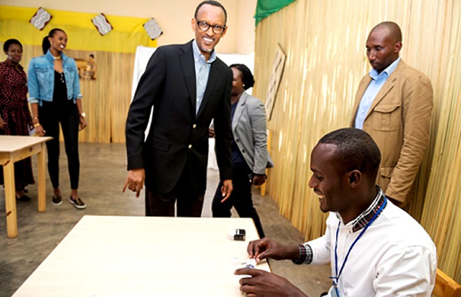 President Kagame getting inked