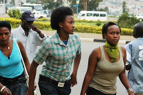 Rwandan youth walking on Kigali streets. Human trafficking crime in Rwanda attracts very harsh punishment