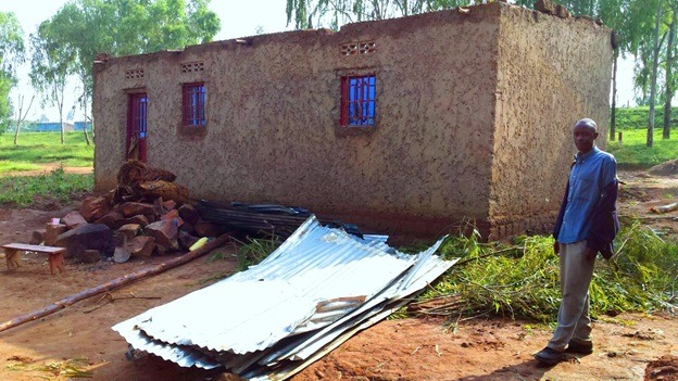 Man ponders next move after rain destroyed his house at Musenyi in Karangazi sector, Nyagatare district