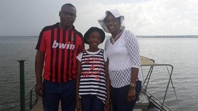 Asante Musangabatware Carine(c), with her parents