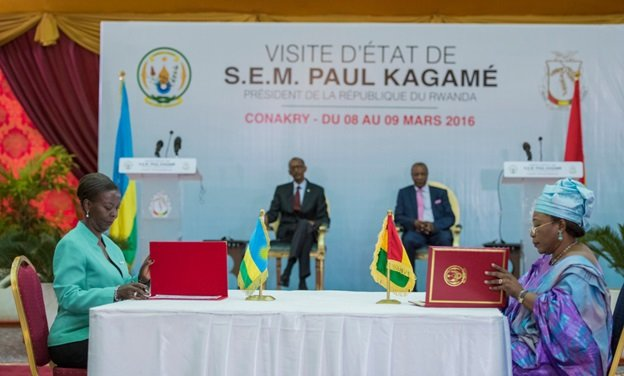 (L)Rwanda's Foreign Affairs Minister Louise Mushikiwabo signing Cooperation MOU