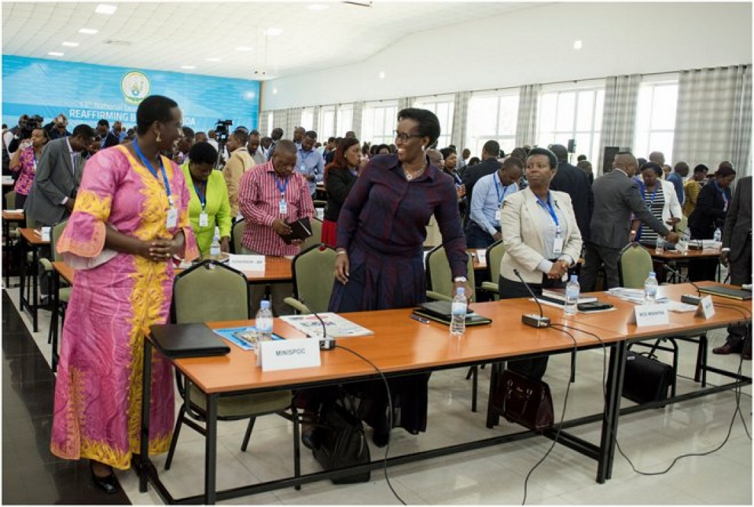 First Lady Jeannette Kagame discussing with Hon. Julienne Uwacu - Minister of Sports and Culture - at the 13th National Leadership Retreat in Gabiro