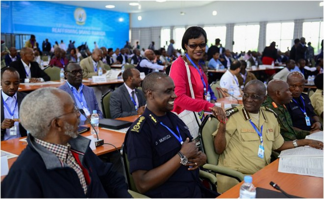 Participants discussing inside the meeting hall on first day of the 13th National Leadership Retreat in Gabiro