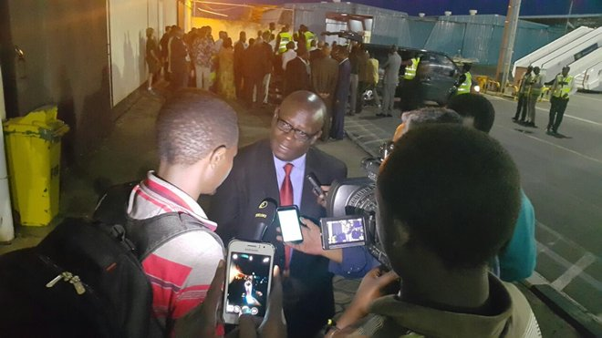 Eugene Murigande speaking to the press upon arrival of the body