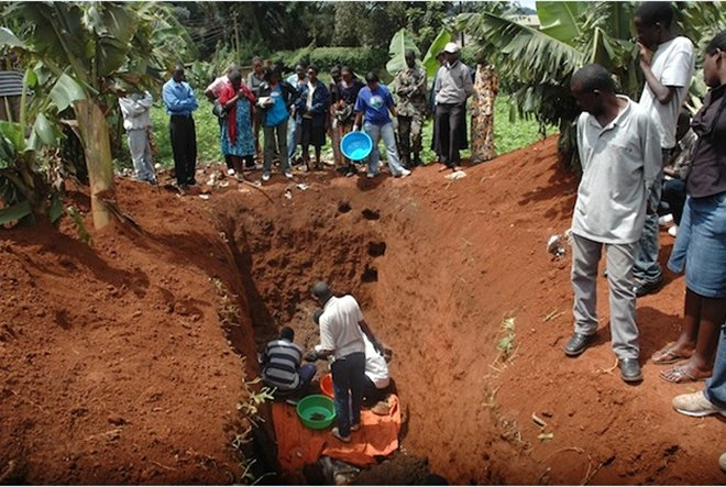 Residents exhume bodies of Genocide victims from a mass grave and later accorded burial in dignity