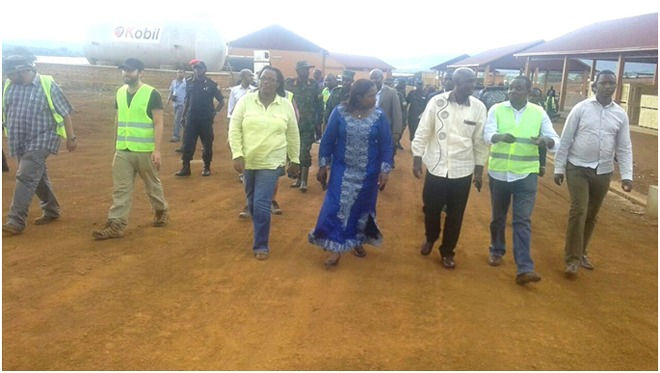 Local government minister Francis Kaboneka (3rd Right) takes a guided tour at the new irrigation project site