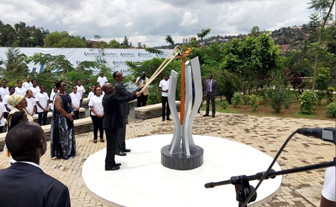 President Paul Kagame and John Pombe Magufuli of Tanzania lighting the flame of Remembrance at Kigali genocide Memorial, in Rwanda's capital Kigali