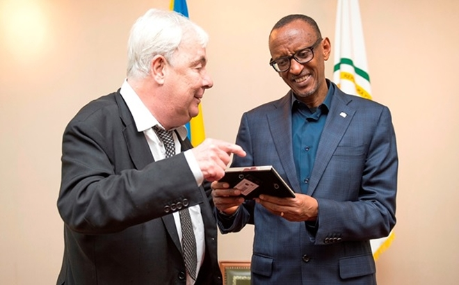Peter Kramer shares a light moment with President Paul Kagame
