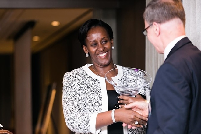 First Lady Jeannette Kagame receives the Humanitarian Award from Team Heart founder Chip Bolman