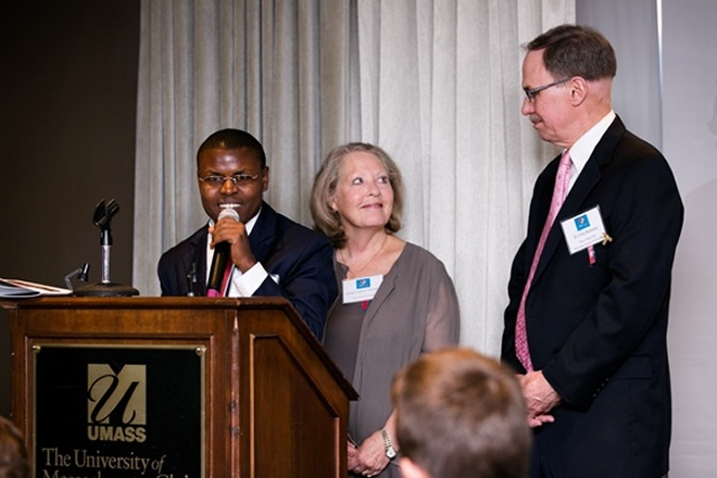 Former patient Ernest Simpunga stand with the Team Heart founders Ceeya and Chip Bolman as he shares his testimony