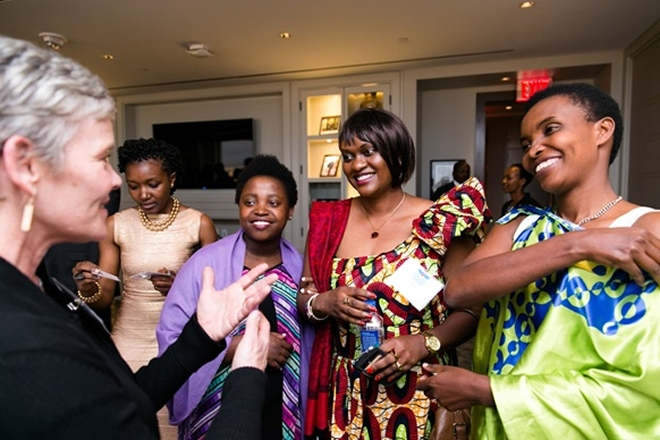 Former patients of Team Heart (second l. and far right) share a light moment with other guests