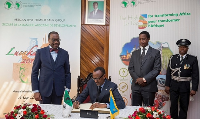President Kagame signs in a book on arrival in Lusaka, Zambia for the AfDB meeting