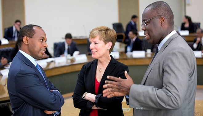 (L)Francis Gatare, CEO of Rwanda Development Board listens attentively during a light discussion