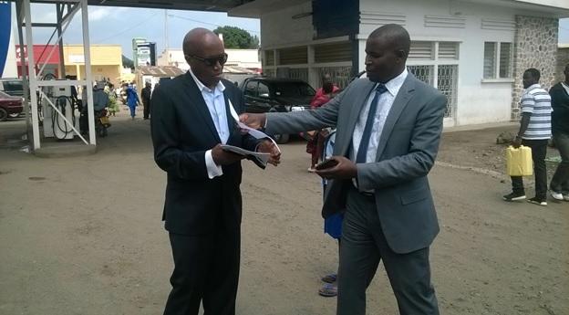 Janvier Busogi(L) handed property ownership documents