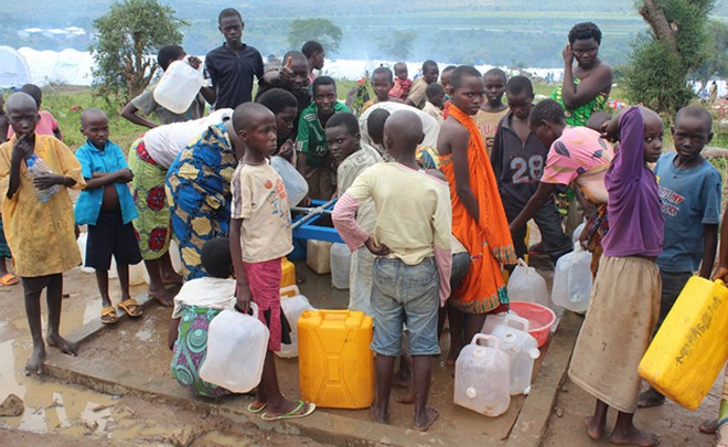 Burundi refugees fetching water at Mahama camp, Rwanda