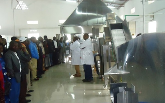 Nyabihu district residents on a guided tour at the potato factory