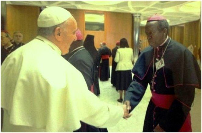 Pope Francis greets Rwanda's Smaragde Mbonyintege the Bishop of Kabgayi diocese