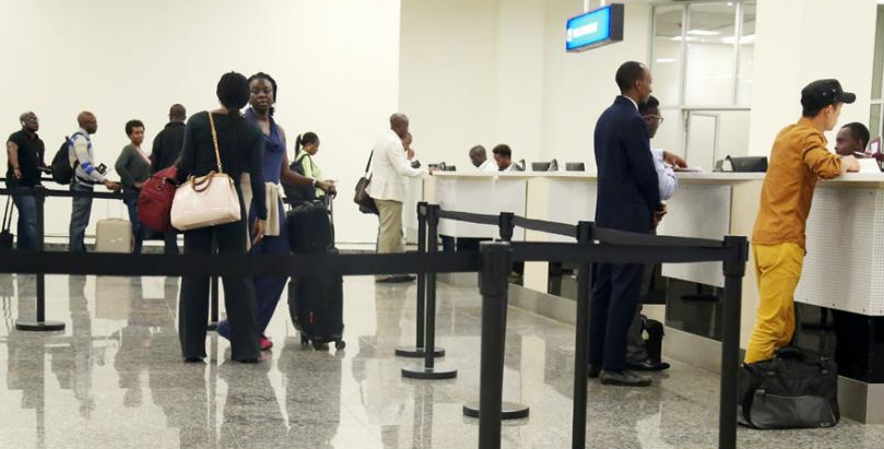 Travelers check-in at Kigali International Airport. Rwanda will begin issuing the Africa Common passport