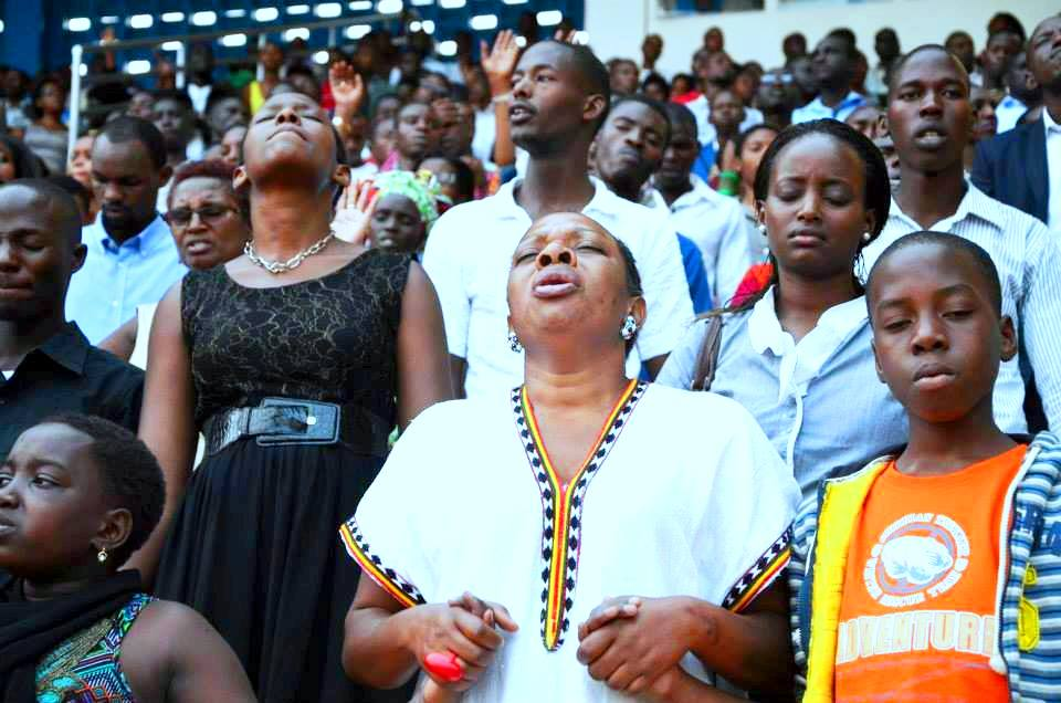 Christians praying at the Rwanda Shima Mana crusade in August 2015 at Amahoro Stadium