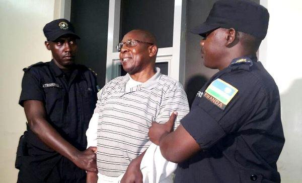 Dr. Leopold Munyakazi handcuffed upon arrival at Kigali International Airport