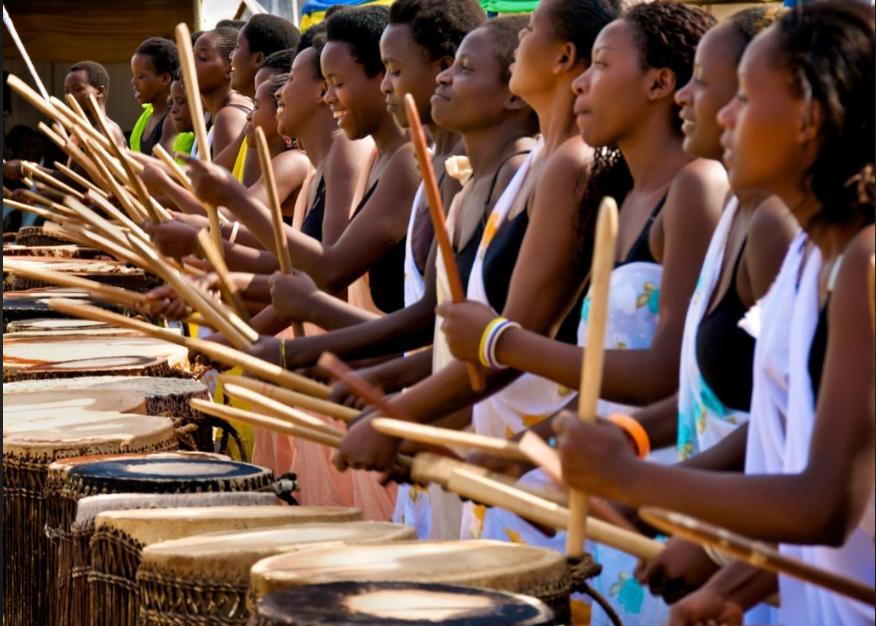 Rwanda women drumming rhythmically