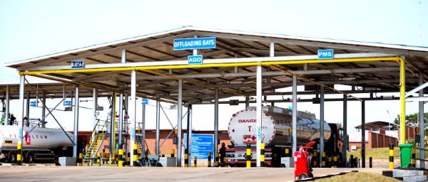 Trucks offloading fuel at depot