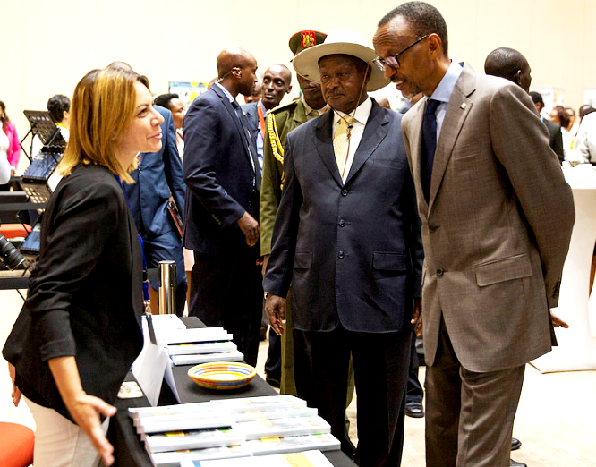 President Paul Kagame and President Yoweri Museveni listen to an exhibitor at The Global African Investment Summit